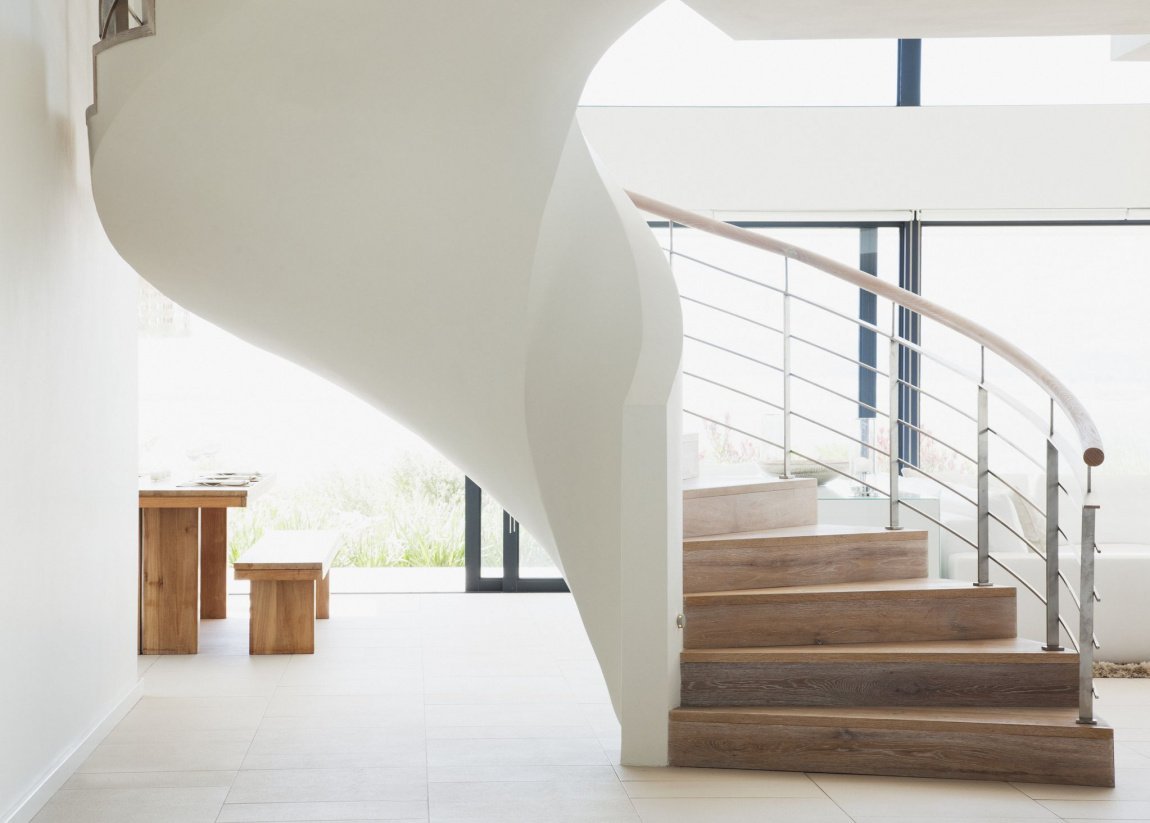 1476461376-curving-staircase-in-modern-home.jpg